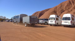 Uluru, Australia. Van Passing By in Parking Stock Footage