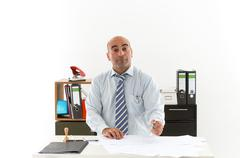 Bureaucrat at work in office with facial expressions Stock Photos