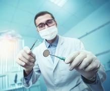 Dentist while working Stock Photos