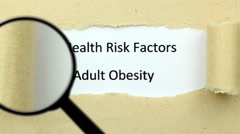 Magnifying glass on obesity risk Stock Footage