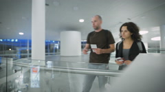 A happy couple discussing their trip at the airport Stock Footage
