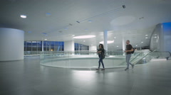 A young couple is waiting for the trip at the airport Stock Footage