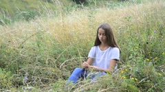 Girl wears beads on nature Stock Footage
