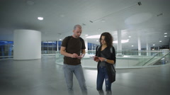 A happy young couple is waiting for the trip at the airport Stock Footage