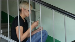 Young Girl Sitting on Stairs and Holding Syringe Stock Footage