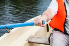 Paddler with oar on boat during water walk Stock Photos