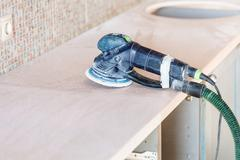 Random orbital sander on new countertop Stock Photos