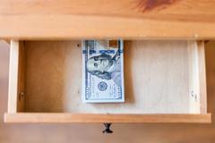 Hundred-dollar bills pack in open drawer Stock Photos