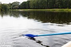 Float on boat with oars in city pond Stock Photos