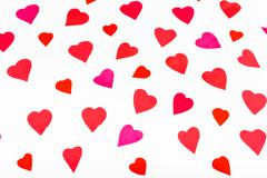 Pink and red hearts cut out from paper on white Stock Photos