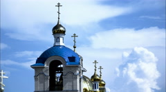 Church with golden domes on a background of drifting clouds and blue sky. Stock Footage
