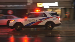 Police vehicle responding to call. Toronto, Canada. Stock Footage