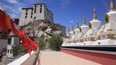 Prayer flags and many tibetan Stupa. Thiksey monastery. Leh, Ladakh, India Stock Footage