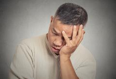 Portrait headshot sad bothered stressed middle aged man Stock Photos