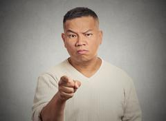 Angry man pointing his finger at somebody Stock Photos