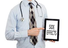 Doctor holding tablet - Side effects Stock Photos