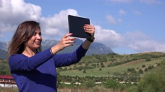 Selfie photo latina young woman in nature take picture using tablet outdoors 4K Stock Footage
