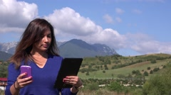 Wired beautiful latina business woman in nature study mobile phone and tablet 4K Stock Footage