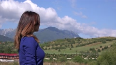 Side view of young latina woman looking on great nature turn to camera and smile Stock Footage