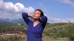 Gorgeous latina woman in nature enjoy wind playing with her hair photo shooting Stock Footage