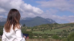 Business woman back side view relaxing in nature looking to the mountains 4K Stock Footage