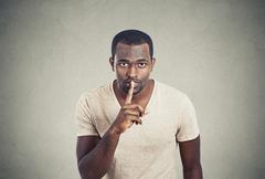 Man with finger on lips gesture keep quiet Kuvituskuvat