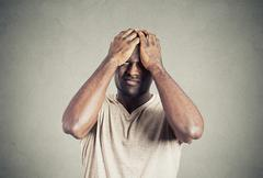 Unhappy upset guy, sad young man bothered by mistakes Stock Photos
