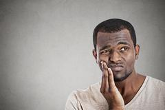 Young man touching face having really bad pain tooth ache Stock Photos