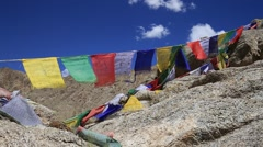 Colorful Buddhist prayer flags at temple in the Shanti Stupa. Leh, Ladakh, India Stock Footage