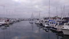 Drone flies over yachts and around beach harbor, San Diego Stock Footage