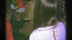 1969: Christmas gifts opening castle mountain playset toy burt plush doll Stock Footage