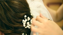 The hairdresser does a hairstyle to the bride Stock Footage