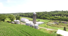 4K Aerial over a silo and corn field on a farm, flying forwards Stock Footage