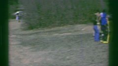 1969: Easter egg hunt kids running to find candy barren scrub brush landscape. Stock Footage
