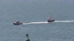Coast guard rescue - ship under tow entering harbor Stock Footage
