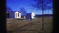 1969: Rural living farming setting residential house autumn early snow melted. Stock Footage