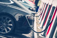 Electric Cars Charging Station Closeup Photo. Stock Photos