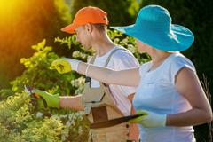 Couple and Their Garden Working to Expand the Garden - stock photo
