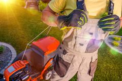 Professional Lawn Mowing and Landscaping. Stock Photos