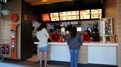 People inside fast food restaurant in Sharjah city, UAE Stock Footage