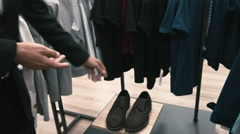 Man buys classic clothes and shoes in shop Stock Footage
