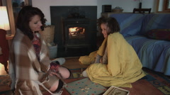 4k Shot in Warm and Cozy Atmosphere of Mom with Son playing near Fireplace Stock Footage