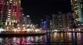 People on the waterfront, night Dubai Marina, United Arab Emirates HD Footage