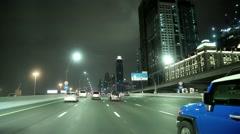 Dubai traffic at night, United Arab Emirates. Burj Khalifa megatall skyscraper Stock Footage