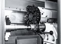 Industrial metal work bore machining process by cutting tool on automated lathe Stock Photos