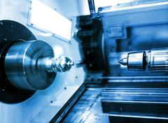 Rotating brilliant part of an automated lathe for machining  metal parts Stock Photos