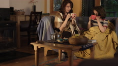 4k Shot in Warm and Cozy Atmosphere of Mom with Son drinking tea near Fireplace Stock Footage