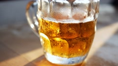 Beer in glass on a wooden table Stock Footage