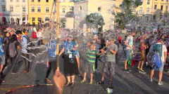 WYD 2016 - Man making many soap bubbles on a happy crowded square - slow motion Stock Footage