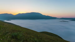 Sunrise with clouds of Castelluccio of Norcia in Italy. Stock Footage